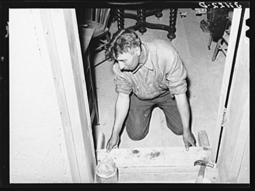 1940 Photo Spanish-American farmer fitting floor step into place. Amalia, New Mexico. The Spanish-Americans are adept in carpentry and cabinet work Location: Amalia, New Mexico, Taos County