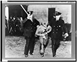 1937 Photo Detroit, Michigan. Police officers removing sit-down strikers from the Yale and Towne Manufacturing plant Location: Detroit, Michigan, Wayne County