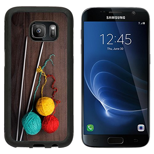 MSD Premium Samsung Galaxy S7 Aluminum Backplate Bumper Snap Case knitting needles and colorful ball of threads on wooden background IMAGE 20870737