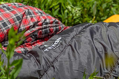 TETON Sports Celsius XXL Sleeping Bag; Great for Family Camping; Free Compression Sack 10 COMFORTABLE SLEEPING BAG FOR ADULTS: Soft lining; Half-circle mummy style hood keeps you warm and your pillow clean; Unzips on each side for airflow and easy access; For camping in 3 seasons NEVER ROLL YOUR SLEEPING BAG AGAIN: TETON provides a great compression sack for stuffing your sleeping bag; Start at the bottom and stuff the bag in, then tighten the heavy-duty straps STAY WARM IN COLD WEATHER: You'll be warm and rested in this sleeping bag; Innovative fiber fill, double-layer construction and draft tubes work together to keep the warmth in