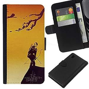 iBinBang / Flip Funda de Cuero Case Cover - CATNISS y BOW - HAMBRE - Sony Xperia Z1 L39