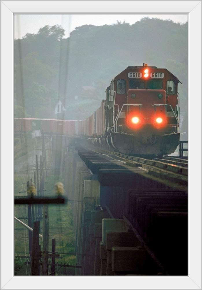 CANVAS ON DEMAND Ron Bouwhuis; Eastbound Canadian Pacific Freight Train, Port Hope, Ontario, Canada White Framed.