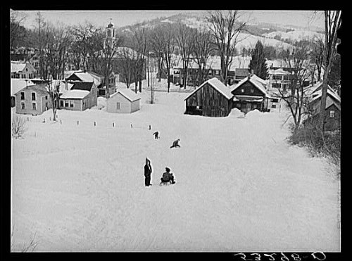 HistoricalFindings Photo: Children sleigh riding down hill in center of town. ()