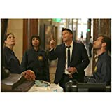 Bones David Boreanaz as Agent Booth Pointing Up and Emily Deschanel as Dr. Temperance Bones Brennan and Tamara Taylor as Dr. Camille Saroyan and T.J. Thyne as Dr. Hodgins Looking Up in Museum 8 x 10 Photo
