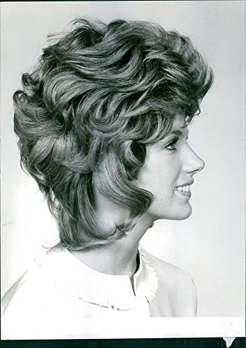 Vintage photo of Portrait of a smiling woman with bubble hairstyle, 1970. -