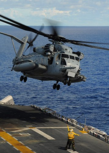 A CH-53E Sea Stallion helicopter takes off from amphibious assault ship USS Essex Poster Print by Stocktrek Images (22 x 34)