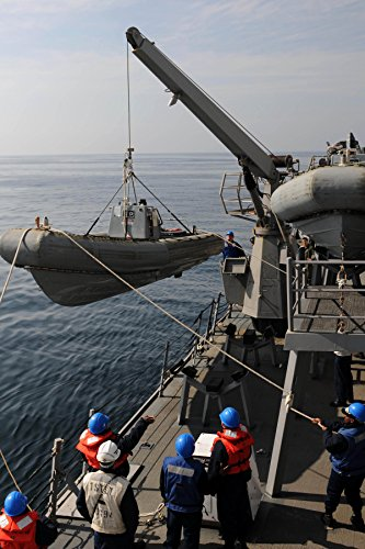Home Comforts Sailors Recover a Rigid-Hull Inflatable Boat Aboard The Guided-Missile Destroyer USS Forrest Sherman