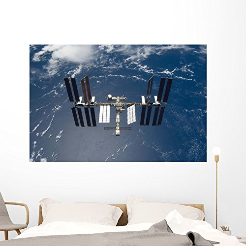 Cheap  Space Wall Murals - The International Space Station Backdropped by a Blue..
