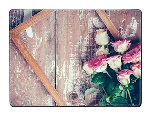 Old Fashioned Rose Bouquet (Luxlady Placemat IMAGE ID 31211338 Bouquet of pink roses and a wooden frame on old board background vintage color)