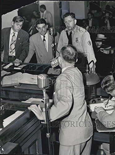 1949 Press Photo Art Barney handling the George Edward sticker,mayoral candicate