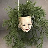 Hanging baby doll head planter