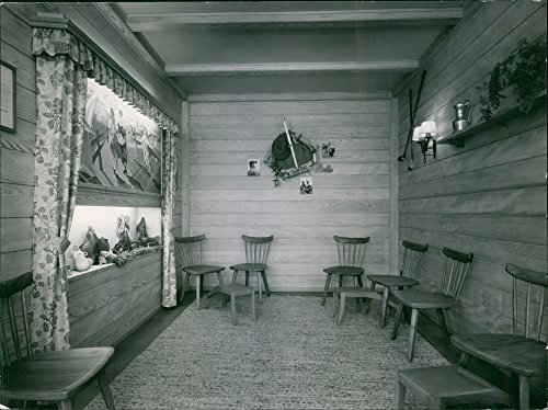 vintage-photo-of-an-empty-room-with-chairs-and-shoesbally-shoes-1951