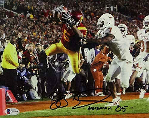 (Reggie Bush Autographed Signed 8x10 Diving Into Endzone Photo with Heisman 05 - Beckett Auth - Certified Signature)
