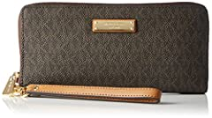 A Michael Kors Jet Set continental wristlet crafted in signature logo print PVC with gold-tone hardware and leather trim. This Michael Kors Jet Set wristlet features a zip-around closure with 3 open pockets, a zip pocket, 2 slip pockets, and ...