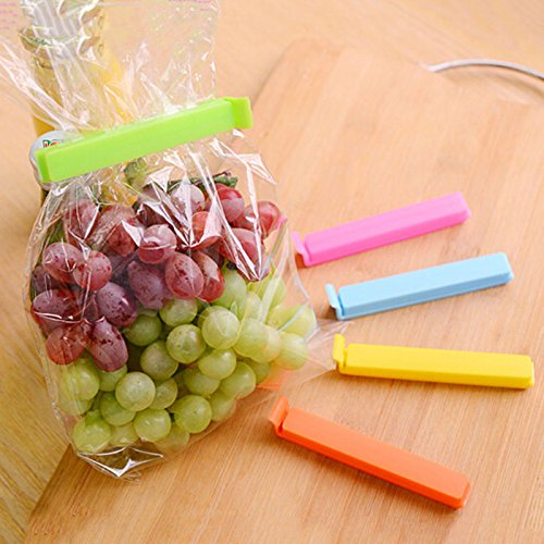 Sealer clips are tied to packet filled with grapes and multicolour sealer kept alongside,a great kitchen tool.