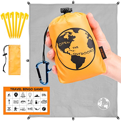 Traveler's Outdoor Gear Pocket Blanket | 70''x55'' Best Lightweight Hiking Tarp for Camping and Backpacking | Comes with 6 Stakes, Bottle Opener Carabiner, Travel Bingo Game and Bag by OpenTheOutdoors by OpenTheOutdoors