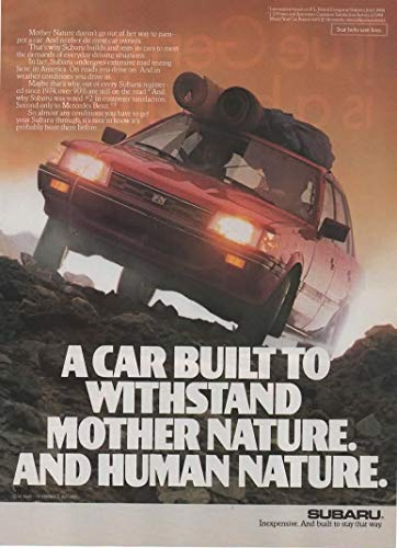 """Magazine Print Ad: 1986 Subaru Sedan 4WD, Off-Road Carpet Rolls on Roof hauling scene,""""A Car Built to Withstand Mother Nature. And Human Nature"""""""