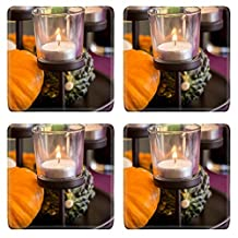 MSD Natural Rubber Square Coasters IMAGE ID: 35184007 Elegant Thanksgiving table decoration with ornamental gourds and a pumpkin on a candelabra with several burning tealights with an overhanging spra