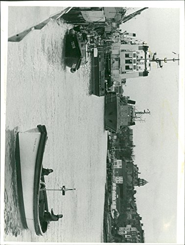 Vintage photo of The Gorleston ferry continues its work as larger vessels seek the safety and calm of Yarmouth ()