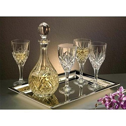A bottle of white wine and wine glasses on a metal serving tray.