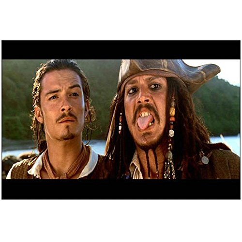 Pirates of the Carribean: The Curse of the Black Pearl Orlando Bloom as Will Turner and Johnny Depp as Captain Jack Sparrow Head Shot 8 x 10 Inch Photo