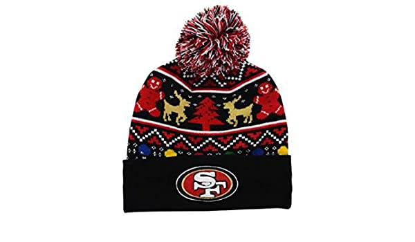 b24d3556ee7cc Amazon.com   New Era San Francisco 49ers Holdiay Cuffed Beanie w  Pom One  Size Hat Cap - Team Colors On Field Christmas Edition Knit   Sports    Outdoors