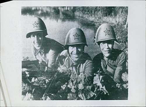 Vintage photo of Three Red Army soldiers smiles at the