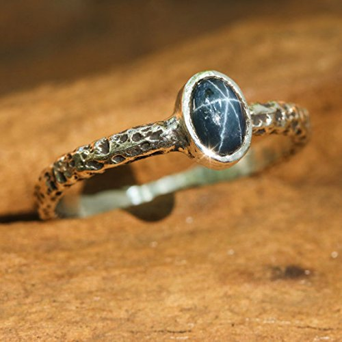 Blue-star-sapphire-ring-in-silver-bezel-setting-with-sterling-silver-oxidized-texture-band