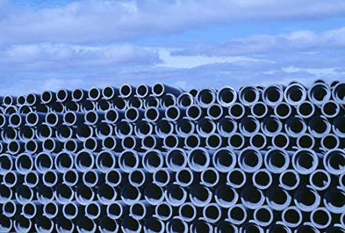 Looking over a stack of pipes which are used in construction industry. Iceland 30x40 photo reprint by PickYourImage
