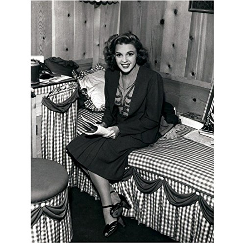 (Judy Garland 8x10 Photo The Wizard of Oz A Star is Born Easter Parade B&W Seated on Bed Looking a Magazine Checked Bedspread kn )