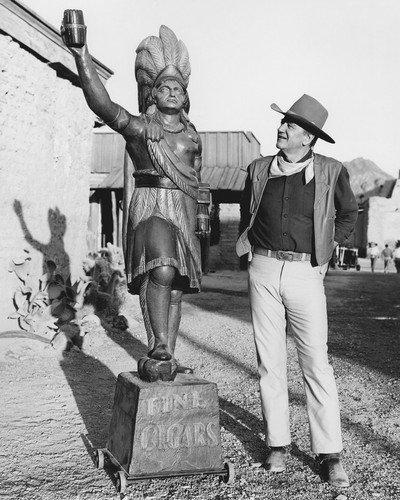 John Wayne standing tall Cigar Store Indian statue on western set 8x10 HD Aluminum Wall Art ()