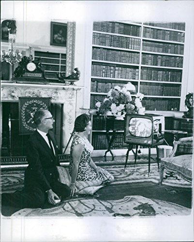 Vintage photo of Duke and Duchess of Bedford, John Ian and Nicole Russell, photographed watching television. 1962.
