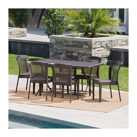 "Paulina Outdoor 7 Piece Multibrown Wicker Dining Set with Foldable Table and Stacking Chairs - The beautiful blend of iron and wicker comes to life with this dining set. Complete with 6 wicker dining chairs, you can enjoy eating in your backyard whenever you want. The rectangular table ensures that there is enough space for both food and people, meaning no one leaves the table hungry. Plus the table is foldable and the chairs are stackable for easy storage when not in use. Includes: One (1) Table and Six (6) Chairs Table Dimensions: 31.50""D x 59.25""W x 29.00""H 