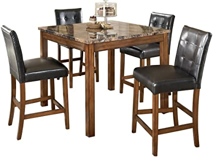 Ashley Furniture Signature Design - Theo Dining Room Table and Barstools -  Counter Height - Set of 5 - Warm Brown and Black
