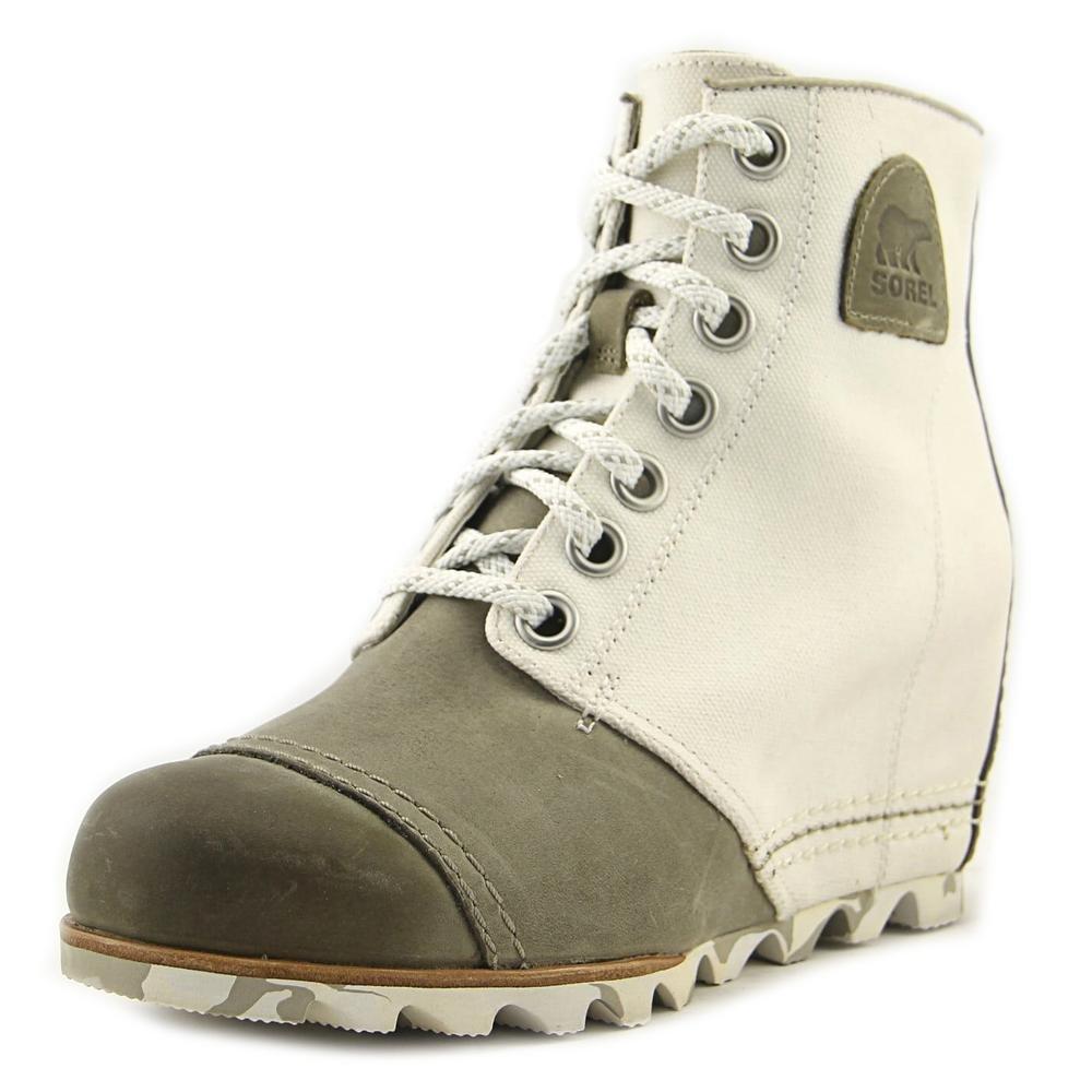 b1f091696f9c Amazon.com  SOREL Women s 1964 Premium Wedge Booties  Shoes