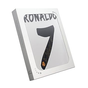 exclusivememorabilia.com Camiseta de fútbol del Real Madrid firmada por Cristiano Ronaldo. En caja