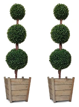Have artificial topiary trees