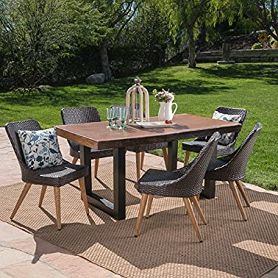 Great Deal Furniture Danae Outdoor 7 Piece Multibrown Wicker Dining Set with Antique Teak Finish Light Weight Concrete Table - The beautiful blend of light weight concrete and wicker comes to life with this dining set. Complete with six wicker dining chairs, you can enjoy eating in your backyard whenever you want. The legs of each chair are made from iron with a wood finish, giving you the aesthetic look of wood with the durability of metal. The light weight concrete material of the table is weather resistant, and virtually indestructible, great for patios that endure those harsh winters and hot summers. Includes: One (1) Table and Six (6) Chairs. Table Material: Light Weight Concrete. Table Leg Material: Iron. Chair Material: Polyethylene Wicker Chair Leg Material: Metal with Wood Finish. Table Finish: Antique Teak. Table Leg Finish: Black - patio-furniture, dining-sets-patio-funiture, patio - 61 8JtYTlbL. SS400  -