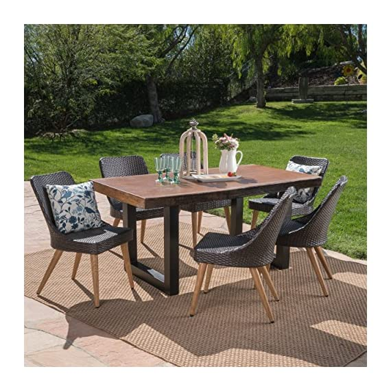 Great Deal Furniture 303805 Danae Outdoor 7 Piece Multibrown Wicker Dining Set with Antique Teak Finish Light Weight Concrete Table, Black - The beautiful blend of light weight concrete and wicker comes to life with this dining Set, complete with six wicker dining chairs, you can enjoy eating in your backyard whenever you want, The legs of each chair are made from iron with a wood finish, giving you the aesthetic look of wood with the durability of metal, The light weight concrete material of the table is weather resistant, and virtually indestructible, great for patios that endure those harsh winters and hot summers Includes: one (1) table and six (6) chairs. Table material: Light weight concrete. Table leg Material: iron. Chair Material: Polyethylene wicker Chair leg Material: metal with wood Finish. Table Finish: Antique teak. Table leg Finish: Black - patio-furniture, dining-sets-patio-funiture, patio - 61 8JtYTlbL. SS570  -