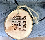 """Customizable 12"""" Rustic wood burnt log: Baby's First Christmas. Age: #months, days baby will be and the year."""
