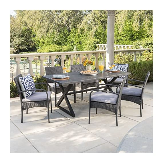 Christopher Knight Home Aster Outdoor 7 Piece Grey Aluminum Dining Set with Grey Wicker Dining Chairs and Grey Water Resistant Cushions - This clean and simple dining set combines the functionality of iron and aluminum with the comfort of wicker. Complete with a table, and 6 wicker dining chairs, this set offers comfortable seating in the great outdoors. Includes: One (1) Table and Six (6) Dining Chairs Table Material: Aluminum Table Frame Material: Steel Chair Material: Polyethylene Wicker Chair Frame Material: Iron Cushion Material: Water Resistant Fabric Composition: 100% Polyester Table Finish: Grey Frame Finish: Black Chair Wicker Finish: Grey Cushion Color: Grey Assembly Required Hand Crafted Details Table Dimensions: 35.25 inches deep x 70.50 inches wide x 29.00 inches high Chair Dimensions: 23.50 inches deep x 22.10 inches wide x 32.75 i - patio-furniture, dining-sets-patio-funiture, patio - 61 FEJGBT8L. SS570  -