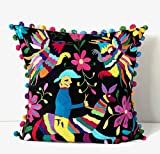 Black Otomi pillow cover made from hand embroidered Otomi fabric. 'man on horse'