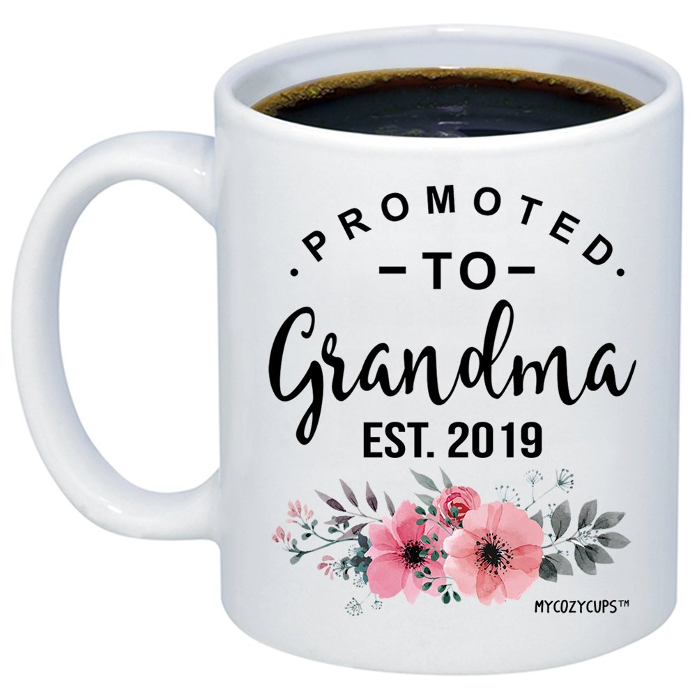 MyCozyCups Baby Reveal Gift For Mom - Promoted To Grandma 2019 Coffee Mug - New Mommy To Be Newborn Novelty Gift Idea For Mothers - New Parents Pregnancy Suprise Announcement Photo Prop Cup For Her