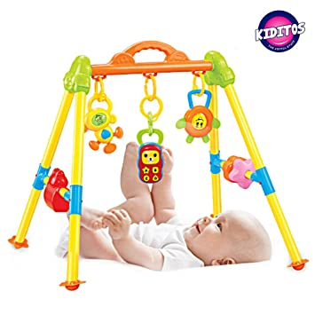 325c6e5ae2503 Buy Kiditos Happy Fitness Frame Play Gym with 20 Songs   Dazzling Lights  for 3 Months + Baby Online at Low Prices in India - Amazon.in