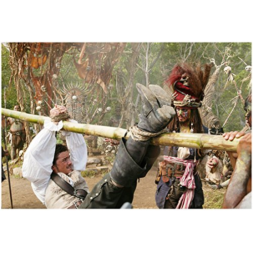 Pirates of the Carribean Orlando Bloom as Will Turner Tied to a Pole with Jack Sparrow as Cannibal Jack Walking Along Side him 8 x 10 Photo (Caribbean Jack Cannibal)
