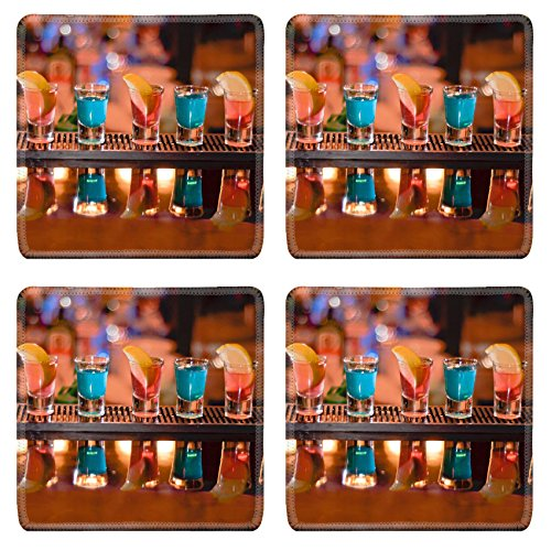 Luxlady Square Coasters IMAGE ID 7989476 Row of shots on the bar tequila and blue curacao