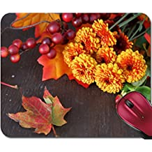 Liili Mousepad IMAGE ID 32464854 Fall or autumn flowers pine cone and berries with orange leaves on a wooden background