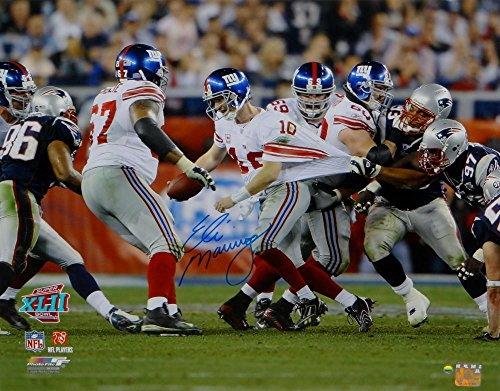 hed NY Giants 16x20 Avoiding Tackle Photo- Steiner Auth (Eli Manning Autographed 16x20 Photo)