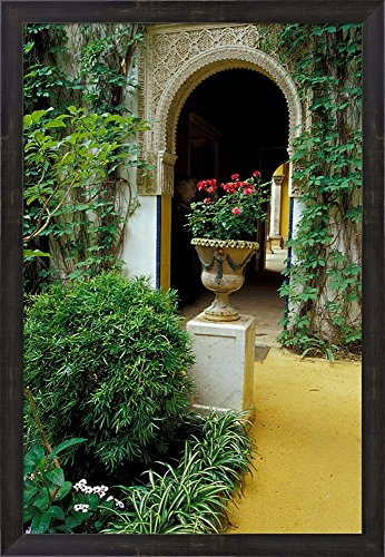Planter and Arched Entrance to Garden in Casa de Pilatos Palace, Sevilla, Spain by John & Lisa Merrill / Danita Delimont Framed Art Print Wall Picture, Espresso Brown Frame, 21 x 30 inches