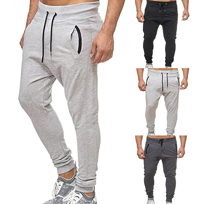 Moda Uomo Sport Jogging Fitness Pantaloni Casual Loose Pantaloni Pantalone  Sportswear Pantaloni Casual Elastico da Uomo 5a24e0be94e